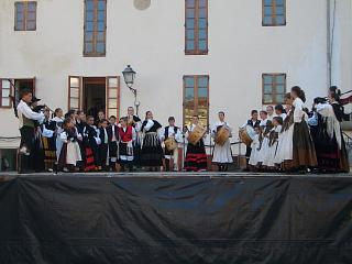 A stage with dancers and traditional instruments